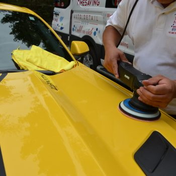 Polishing the hood of a sports car during mobile auto detailing by Time Saving Auto Detail