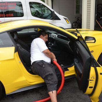 Vacuuming car interior - mobile car detailing - Time Saving Auto Detail