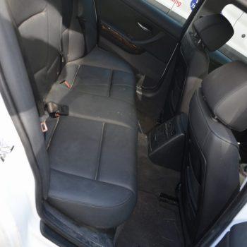 dirty car interior before detailing - rear seat